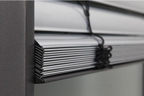 The design of the slim rolled edge slat incorporates a unique flared edge detail for strength and compact stacking.
