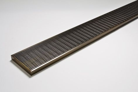 Stormtech now offers its architectural style wedge-wire grates in a variety of warm bronze finishes.