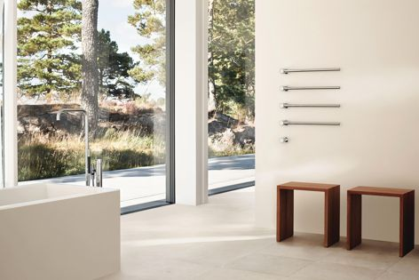 Vola's T39 built-in modular heated towel rail is available in 18 colours and finishes including polished chrome and brushed stainless steel.