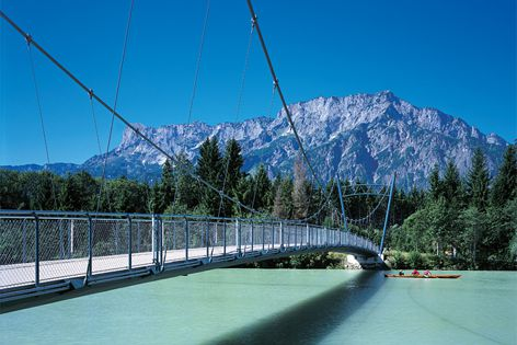 Suspension bridges provide a lightweight and flexible structure suitable for large and short spans.