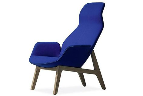 The Ventura lounge chair features comfortable upholstery and refined design.