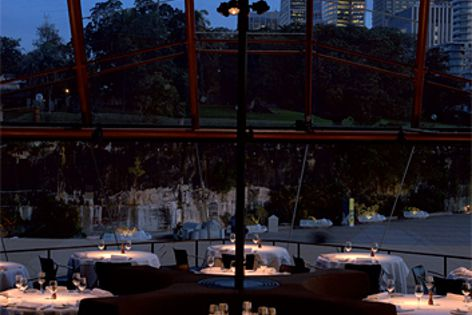 Erco's Light System Dali reflects a gentle pool of light onto each table at Guillaume at Bennelong.