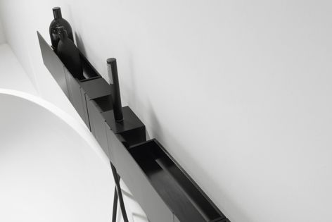 Sen by Agape is a modular system of taps and accessories made from brushed anodized aluminium.