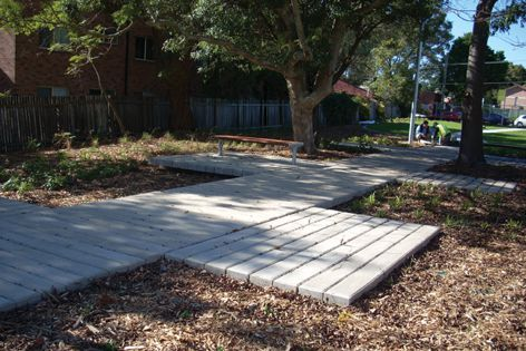 PermaTrak concrete boardwalk system was installed to help protect exposed tree roots.