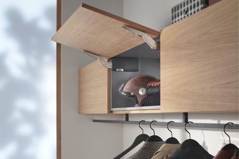 Installing overhead cabinets that lift up and out of the way instead 
