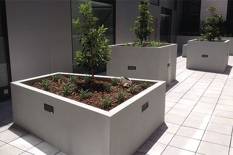Planter boxes at Hudson Apartments, Hawthorn, constructed from Paneltim plastic panels and rendered.