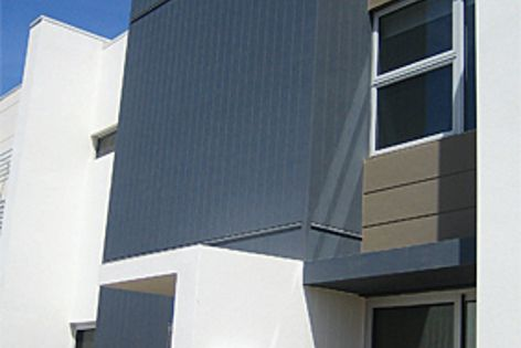 Scyon™ cladding, an advanced lightweight cement composite material.