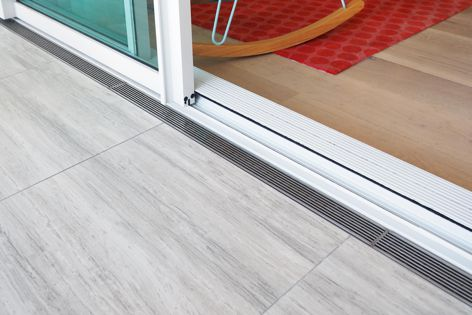 Stormtech's Threshold drains allow uninterrupted access between indoor and outdoor living areas.