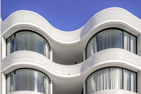 The Campbell Parade apartments by Tzannes feature glazing by Bent and Curved Glass. Photography: Ben Guthrie.