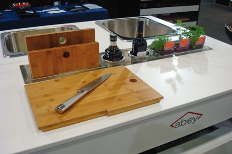 Essential cooking tools are stored neatly within the Canale benchtop from Abey.