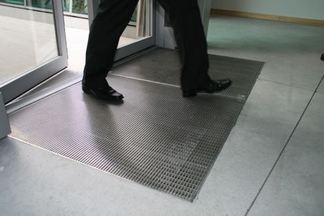 Custom-made stainless steel drainage mats by Stormtech enhance not only the function of entry areas, but also the look.