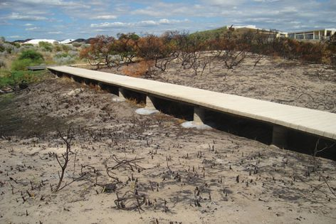 This reinforced-concrete PermaTrak boardwalk by Rocla survived a bushfire in 2008.