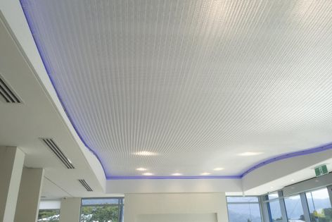 The ceiling at MyStyle Design Centre, Cairns features Kaynemaile seamless mesh in 'Water Clear.'