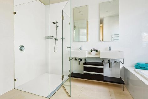 Corian surfaces are warm and sensual to the touch. With no grout lines, it's easy to clean, making it great for use in showers and on floors.