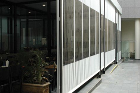 PVC was incorporated into Swela fabric to enable a view from Markilux blinds at this Sydney cafe.