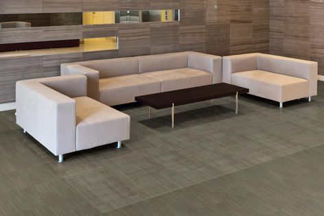 The award-winning collection features soft, linear patterns and is available in tiles and planks.