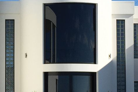 Toughened curved double-glazed units manufactured by Bent and Curved Glass help boost the thermal performance of this new residence.