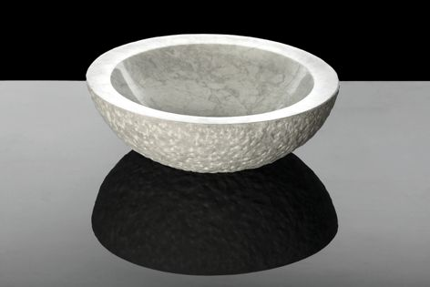Carrara marble handbasins are a classic addition to a contemporary bathroom design.
