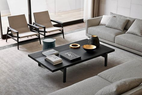 Designed by Jean-Marie Massaud, the Home Hotel coffee table is crafted from solid wood.