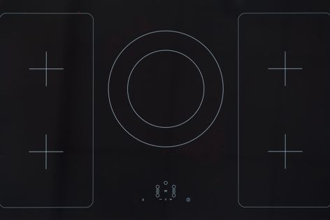 Ilve's sleek black glass induction cooktop is designed to fit seamlessly into the modern home.