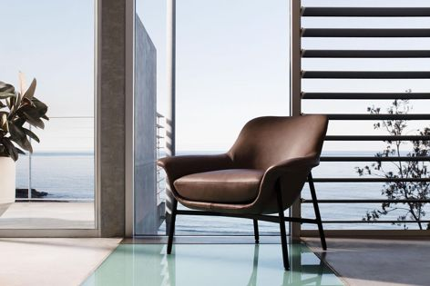 King Living's Seymour chair, designed by Charles Wilson, is available with three different back heights and a swivel or fixed base.
