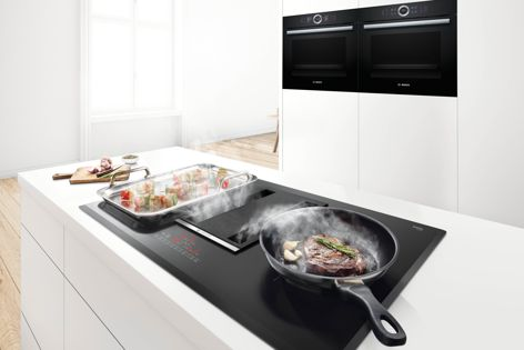 The Bosch 2-in-1 cooktop includes an integrated rangehood that extracts steam and odours directly from pots and pans.