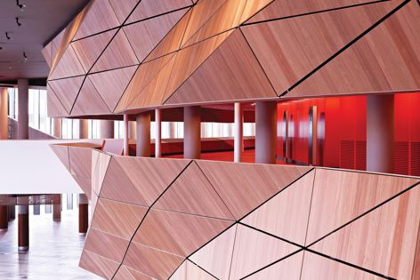 The Plenary, Melbourne Convention and Exhibition Centre by Woods Bagot and NH Architecture features custom-made Laminex timber veneer. A similar look can be achieved with Laminex Designed Timber Veneer Panels in Blackbutt Wave or Spotted Gum Wave.