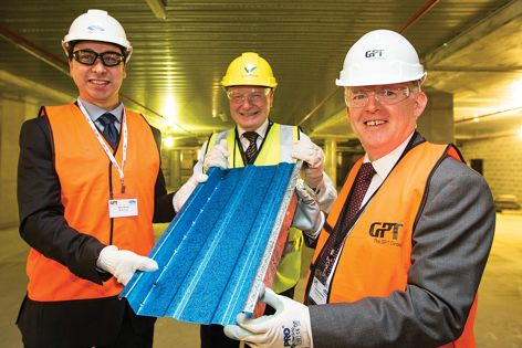 With a piece of the new Low-Glare Coated Deckform from Bluescope are (L–R) BlueScope's Coatings and Product Technology manager Sean Wong, the Lord Mayor of the City of Wollongong Gordon Bradbery and The GPT Group's Head of Development – Retail and Ma