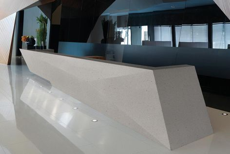 Corian's Solid Surface with Resilience Technology, pictured in 'Cool Grey,' offers superior scratch resistance and quick stain removal.