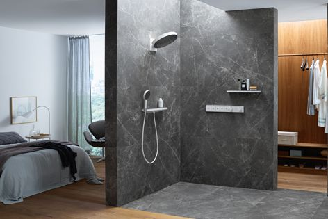 Rainfinity's large overhead and hand showers have contemporary surface finish colours and discreetly structured spray plates that add a textural layer to a modern bathroom colour palette.