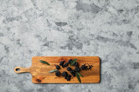Essastone in 'Luna Concrete' has a hand-trowelled aesthetic, with shallow dimples and ridges providing tactility and an industrial edge.