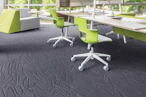 Confluence, part of the Intrinsic carpet plank collection. The collection offers a range of colours and patterns.