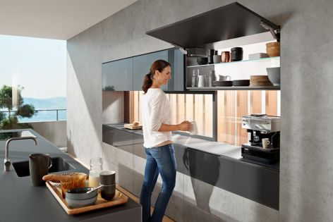 The AVENTOS HK top from Blum can be used in any space throughout the home.