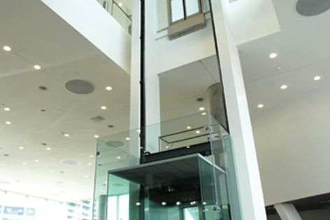 Liftonic installed a custom glass lift with an open atrium tower for this Audi showroom in Sydney.