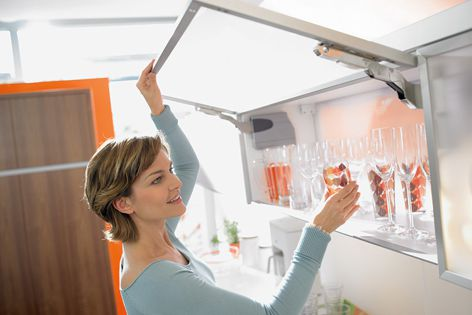 Wall cabinets open effortlessly with Blum's Aventos lift system.