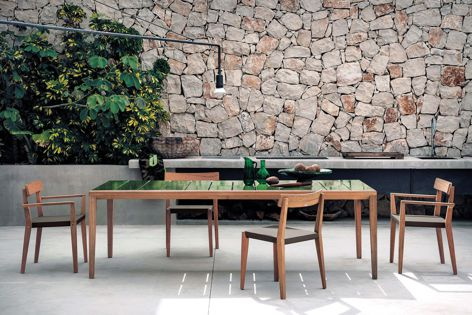 Teka outdoor dining collection by Roda includes the teak 171 chairs and 174 table featuring an optional glazed gres jade finish.