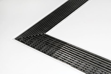 The Stormtech 65AS stainless steel grate is ideal for bathrooms and outdoor applications.