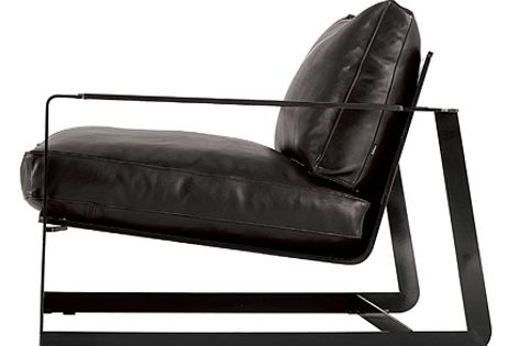 The lacquered metal frame of Poliform's Gaston chair is available in glossy black or white.