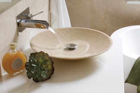The Illuka low line basin is handcrafted from a single piece of marble.