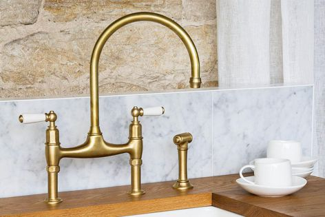 The Perrin & Rowe Ionian kitchen tap in satin brass.