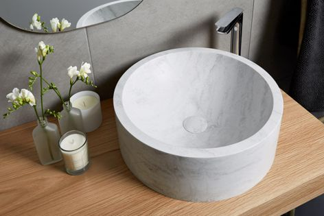 The vessel basin in Rain Cloud is part of the innovative range of DuPont Corian basin, sink and work surface products.