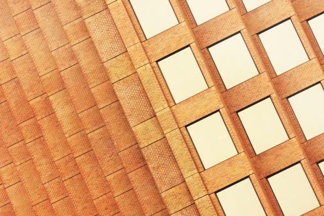 InBrick by PGH Bricks and Pavers is an inlay system that embeds genuine clay brick tiles into precast concrete panels.